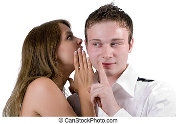 The young woman whispers on an ear to the young man