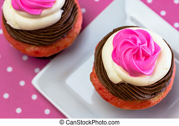 Neapolitan Cupcakes - Close up of 2 neapolitan frosted...