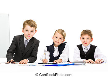 Group of little business people sitting at the table