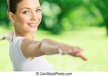 Portrait of working out girl with outstretched arms -...