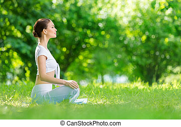 Profile of woman in asana position - Profile of woman who...