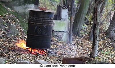 cooking in a barrel smoke fish Tripod close to Loop