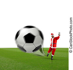 Santa Calus kicking a soccer ball on the grass and white...