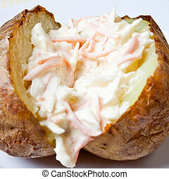 Hot and crispy baked potato stuffed with coleslaw