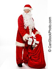 Santa Claus with christmas sack and gift boxes isolated on...