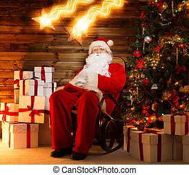 Santa Claus sitting on rocking chair in wooden home interior...