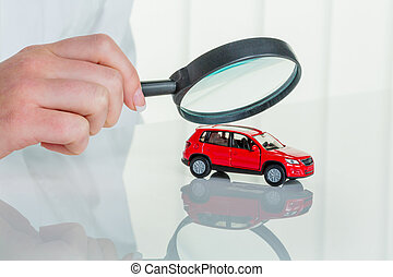 car is checked by doctor - a model of a car is examined by a...