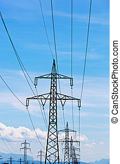 flow line - a high voltage power pylons against blue sky.
