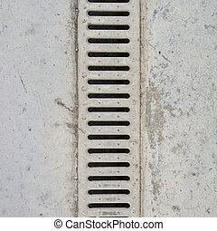 Drain grate in concrete floor