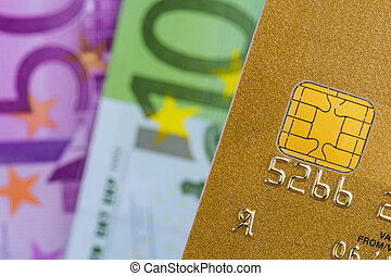 credit card and euro banknotes - a gold credit card and euro...