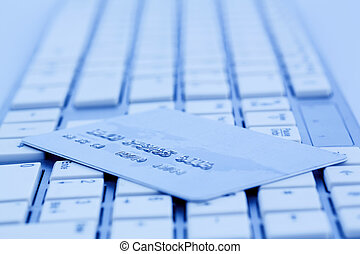 credit card and keyboard - close-up a credit card for...