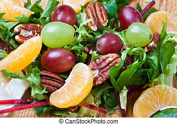 Healthy green salad with grapes