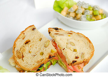 Fresh sandwich with fruit salad