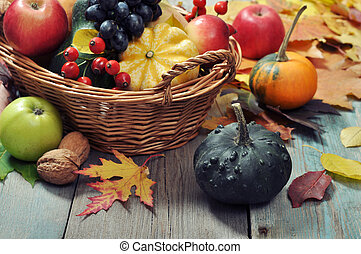 Thanksgiving concept - Fresh ripe pumpkins, apples, grape...