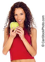 woman holding greeen apple - Curl hair brunette woman...