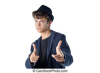 Cute teenage boy in cool pose
