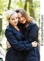 Embracing Loving Sisters - Two beautiful sisters in a park...