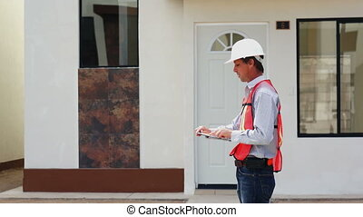 Male Foreman Takes a Call - A handsome, male, construction...