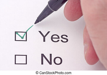 Yes - Someone indicating yes on a survey in green pen