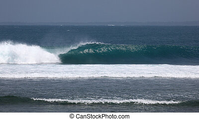 Indonesian Wave - A beautiful wave goes unridden on a coral...