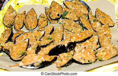 Aperitif fish - tasty breaded mussels