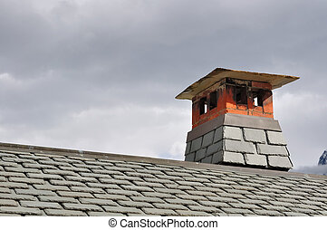 vent of chimney on the roof of a mountain cottage