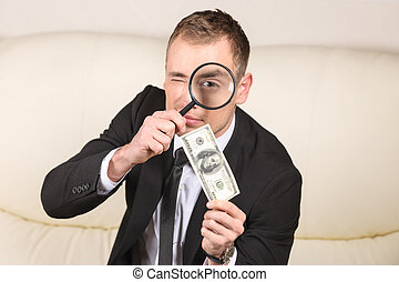 Businessman with magnifying glass - Businessman looking...