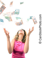 Catching money - Nice girl catching falling money
