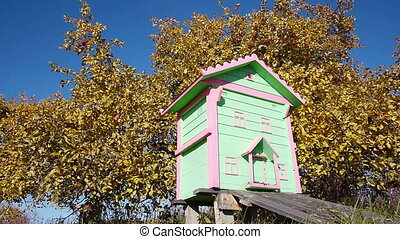 Honey bee hives in autumnal apple garden