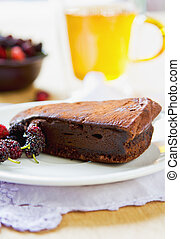 Chocolate truffle torte by berries and tea