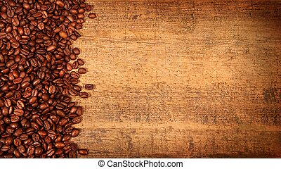 Roasted coffee beans on rustic wood