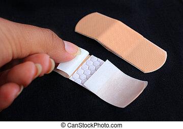 Medical adhesive bandage on black background