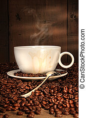 White coffee cup with spoon on roasted beans