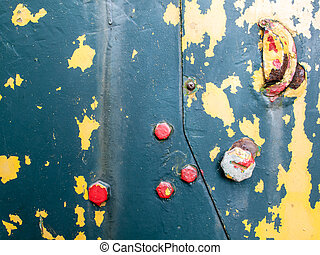 flaking paint on rusty iron with bolts