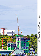 Building under construction and cranes
