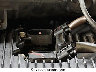 Modern car gasoline engine servicing, ratchet and spark plug