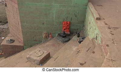 lingam and gods near Ganges river - small sacred place with...