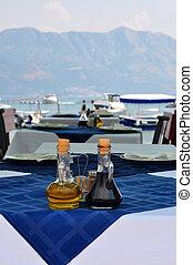 bottle of olive oil and italian balsamic vinegar on blue...