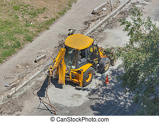 tractor performs road works to repair pavement - small...