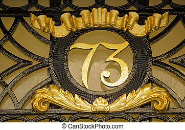 Number Seventy Three - Ornate metal sign for number 73 on...