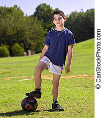 boy and ball - young boy and ball in the park