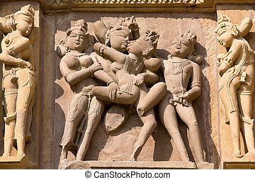 Erotic temple in Khajuraho, India. - Stone carved - fragment...