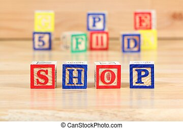 Shop - Wooden blocks with letters. Children educational toy...