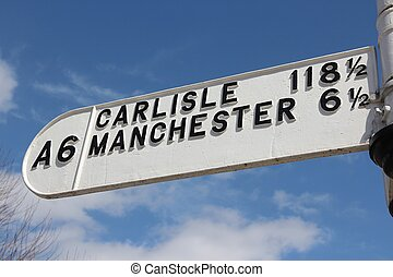 Road sign in England: A6 road to Carlisle and Manchester....
