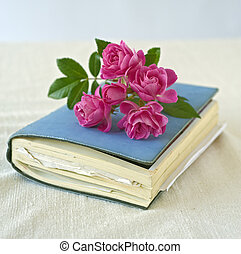small roses on a diary - bouqet of small roses on a diary,...
