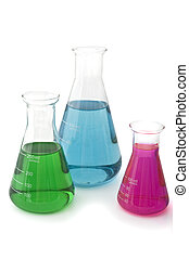 lab flasks - three lab flasks with blue green and magenta...