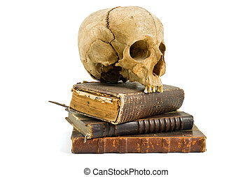 skull and old books isolated on white