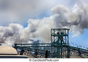 white smoke stacks in old factories