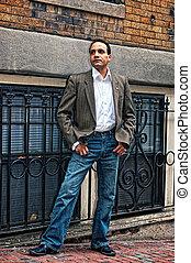 man posing on sidewalk