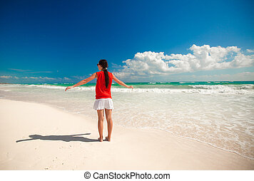 Young beautiful woman enjoying holiday on the beach